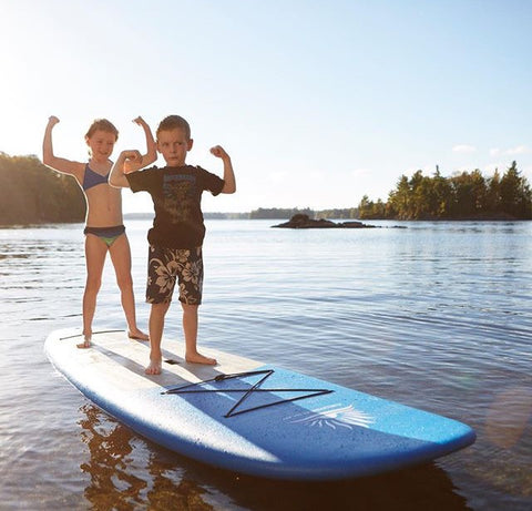 Kids riding SUP Board