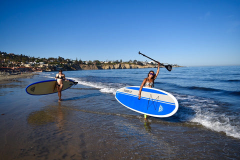 Paddle Boarders holding paddles