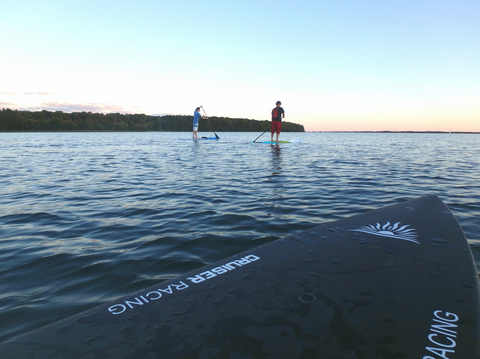 Two Paddle Boarders in a photoshoot
