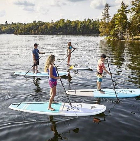 A family stand up paddle boarding on hard stand up paddle boards