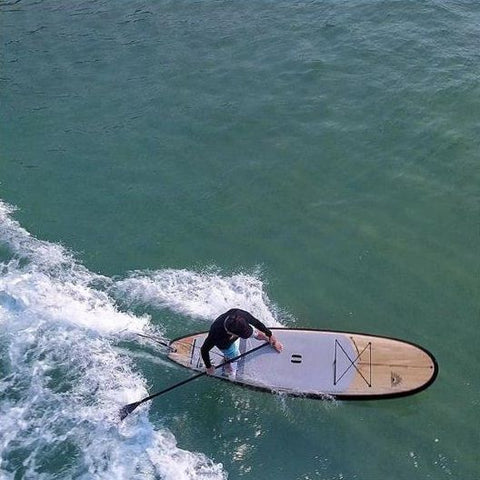 A man stand up paddle board surfing