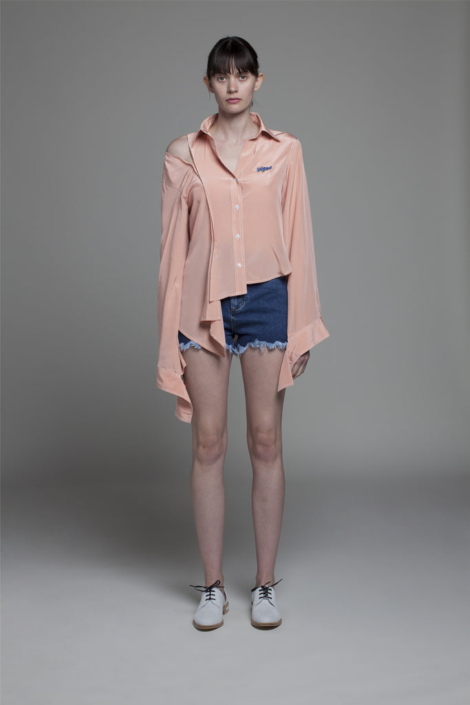 ASYMMETRIC SHORTS WITH FRINGES