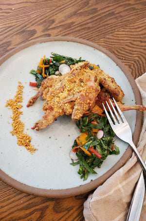 Spicy Peanut Crusted Quail with Collard Green Salad