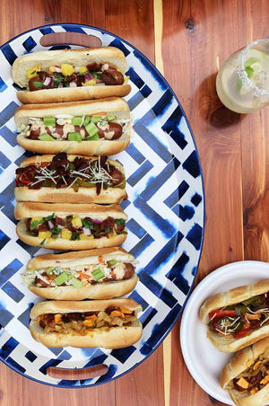 Bye bye boring ketchup. Four delicious new hot dog toppings.