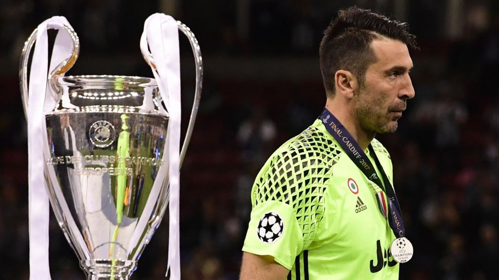 Buffon walks by the UCL trophy