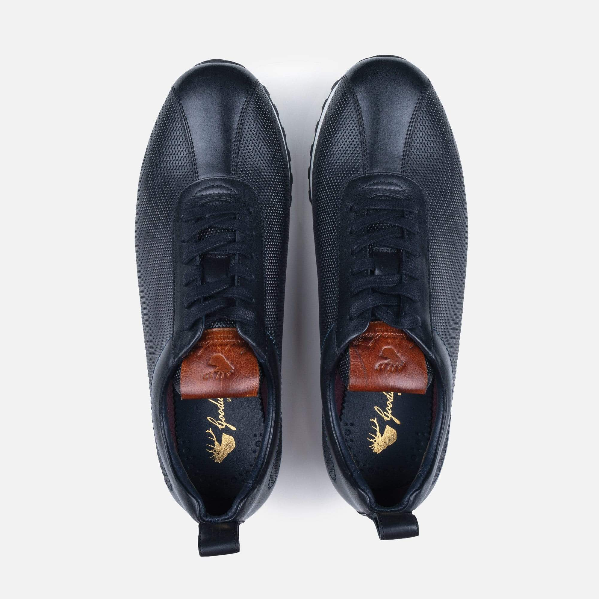 Leather padded collar lining and stag printed canvas lining in black leather trainer