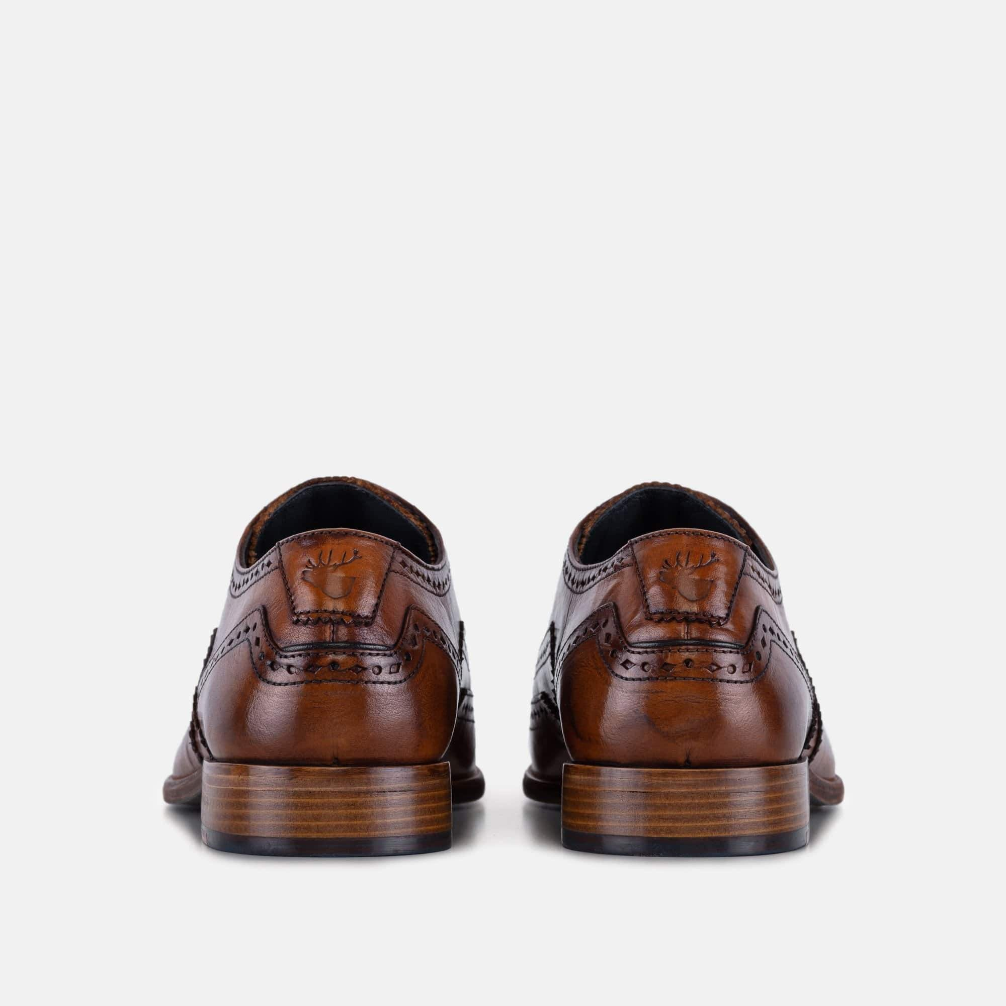 Tan derby brogues for men with stag logo debossed to the heel