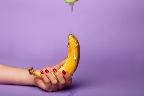 lubricant being poured in a yellow banana