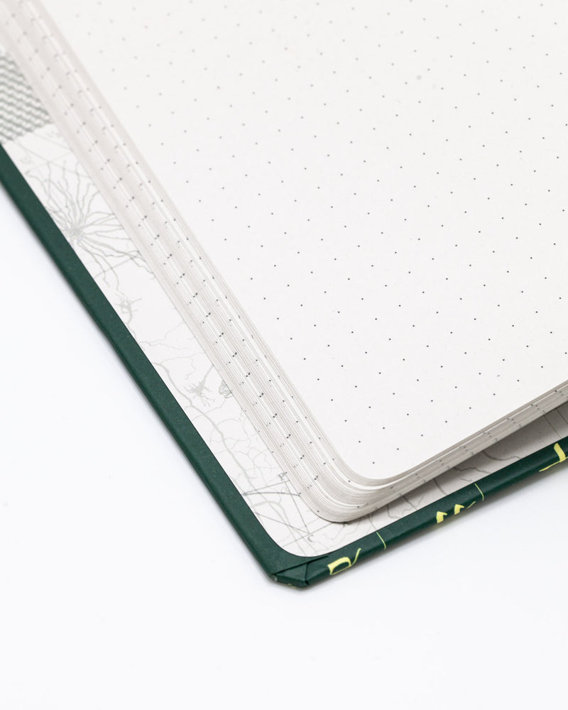 Inside cover of Linguistics hardcover dot grid notebook by Cognitive Surplus, emerald green, 100% recycled paper