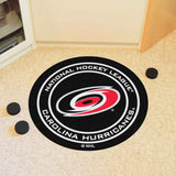 Carolina Hurricanes Hockey Puck Area Rug in Room