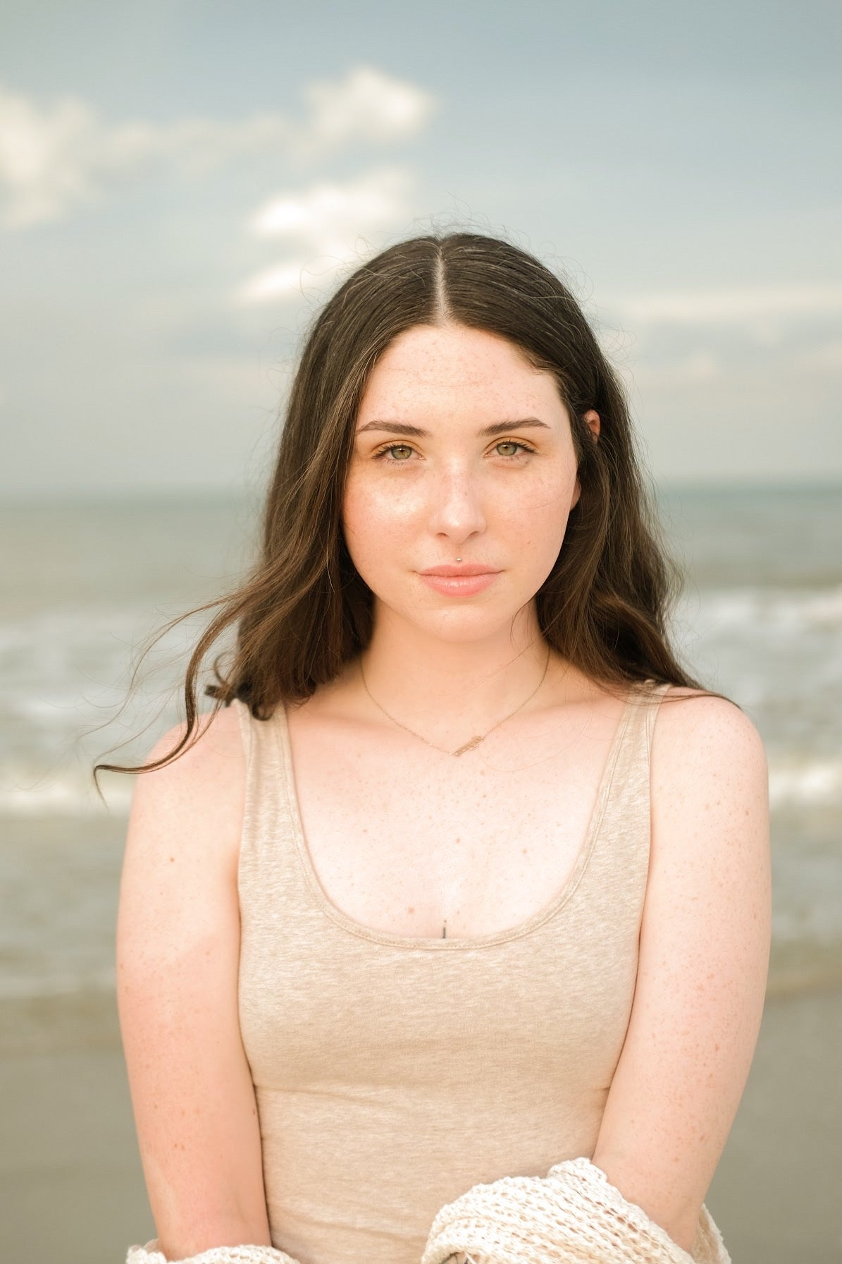 Porcelain skin girl - serious expression - beach background that looks like a renaissance painting.