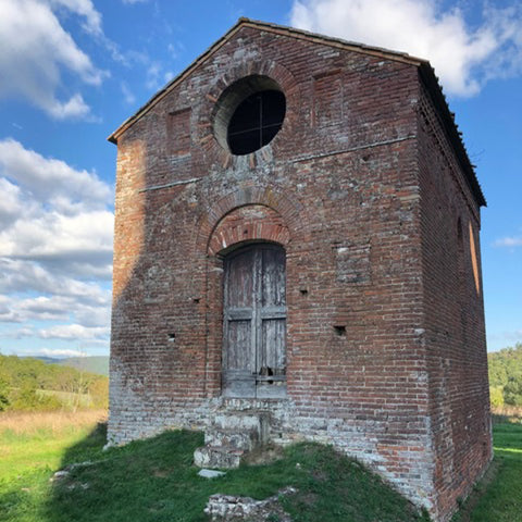 Tuscan Style Home Décor: A Guide The 5 Main Things to Know - One of my favorite buildings is this small Tuscan structure next to the massive abandoned Abbey of San Galgano, which is located in Chiusdino, Italy in Tuscany.
