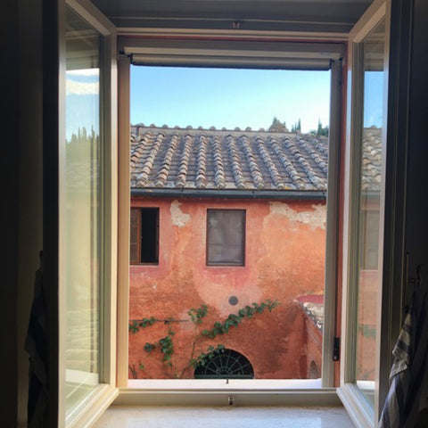 Tuscan Style Home Décor: A Guide The 5 Main Things to Know - A colorful view from the kitchen in the house where I stayed on my recent buying trip in Italy