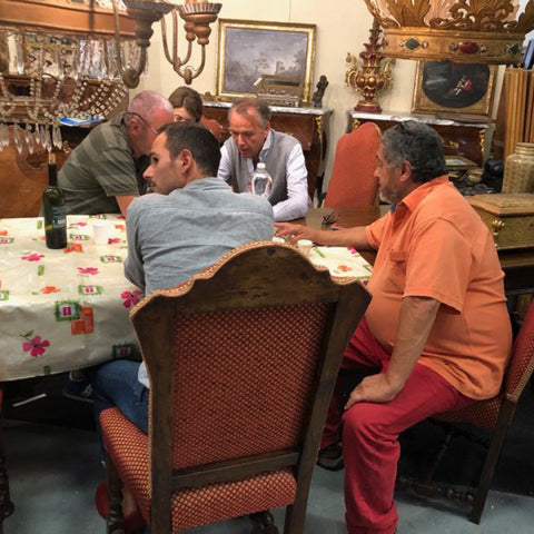 Tuscan Style Home Décor: A Guide The 5 Main Things to Know - Tuscan antique dealers relaxing over the lunch hour at the Parma Antique Fair