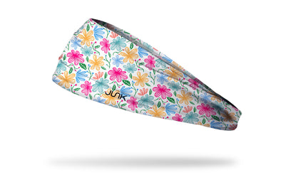 white headband with yellow pink and blue floral daisy print
