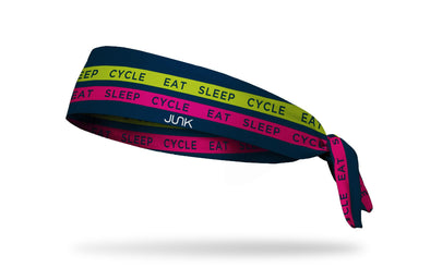 navy headband with red and yellow bands that say eat sleep cycle in a repeating pattern