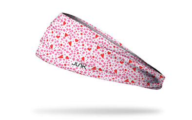 white headband with repeating pattern of dots and hearts in pink and red