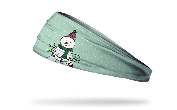 light blue winter christmas themed headband with snowflakes and snowman wearing knit hat and scarf