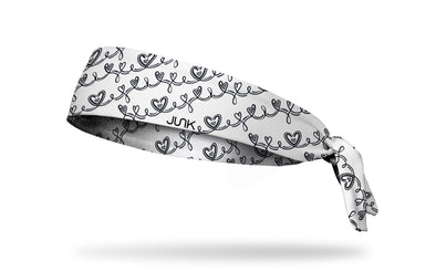 white headband with repeating pattern of infinity symbols and hearts in black