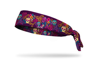 dark purple headband with turquoise cream gold and bright pink floral accents and sugar skulls