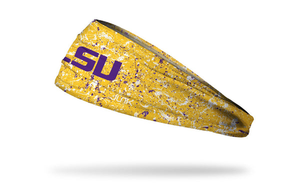 yellow gold headband with paint splatters and Louisiana State University logo