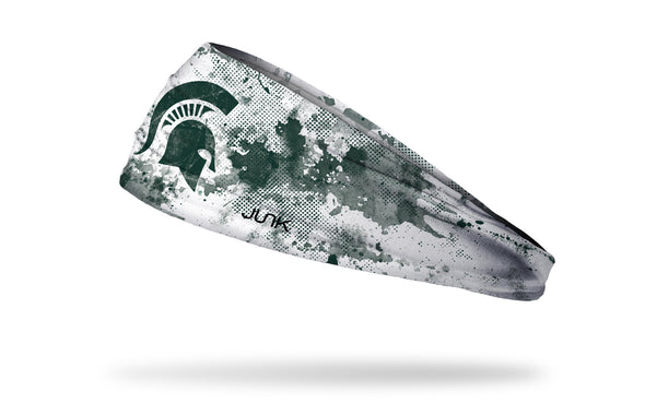 white headband with Michigan State University spartan logo in green with green grunge overlay