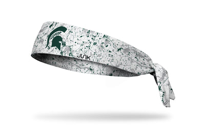 white paint splatter headband with Michigan State University spartan logo in green