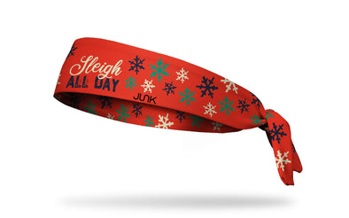 red winter christmas themed headband with sleigh all day wordmark and snowflakes