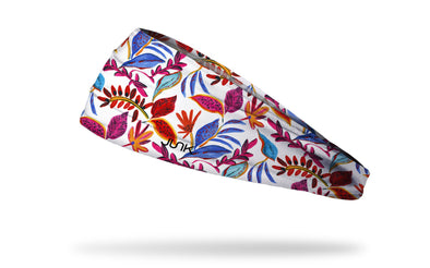 white headband with repeating colorful tropical floral and leaf pattern in pink blue red orange and yellow
