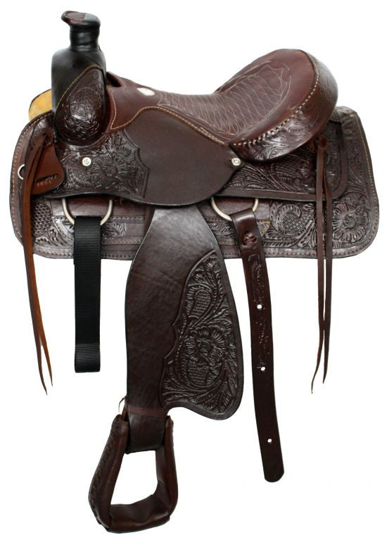 "16"" Acorn tooled Buffalo roper style saddle with smooth leather seat."