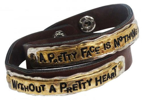 """ A Pretty Face is Nothing without a Pretty Heart"" leather wrap around bracelet."