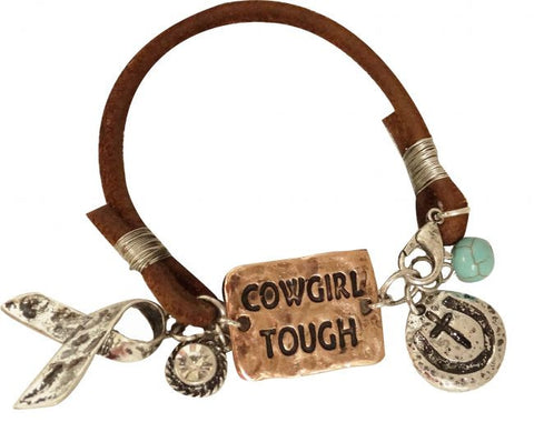 """ Cowgirl Tough"" copper bracelet. Brown leather strand with charms and a silver ribbon charm."