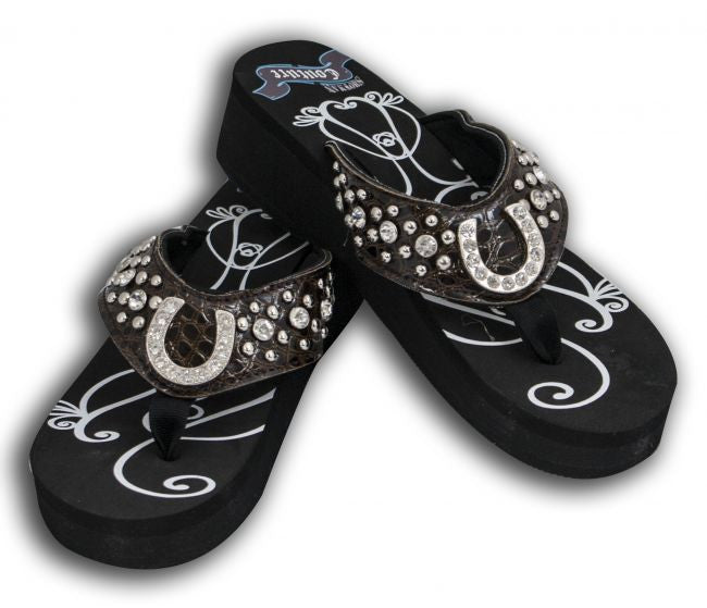 Showman Couture ™ Ladies western bling flip flops with horse shoe conchos and snake print band.