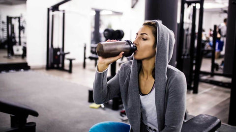 woman-in-gym-drinking-protein-shake