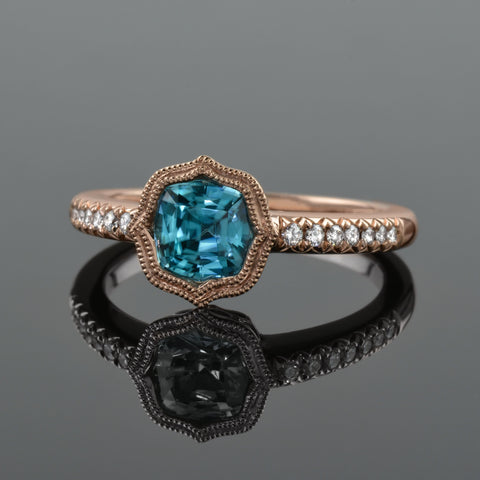 blue zircon ring set in rose gold.