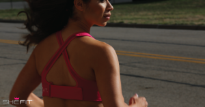 Woman jogging in the Shefit Ultimate Sports Bra