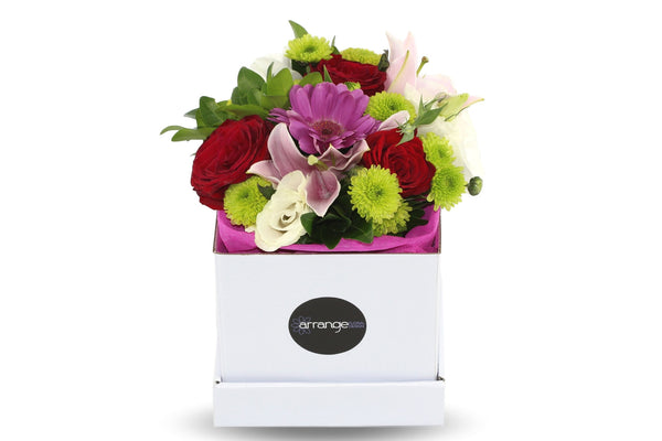 A sweet petite posy full of an assortment of seasonal flowers