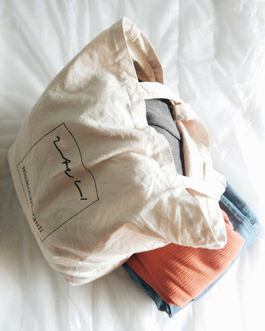 tote packed with clothes