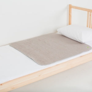 Medium PeapodMat on top of single bed in Sandman colour