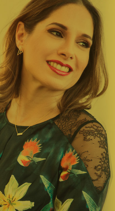 Adriana Mother Co Founder of Adriana Fine Jewelry wearing earrings and necklace in 14k yellow gold with diamonds
