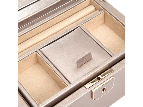A delicately constructed leather jewelry case, the Palermo collection represents a city synonymous with sophistication.  Includes:  1 ring roll 4 storage compartments Glass mirror Teju lizard embossed leather in brown, coral or blush LusterLoc™ anti-tarnish lining and lock & key with gold finish. LusterLoc™ allows the fabric lining the inside of your jewelry cases to absorb the hostile gases known to cause tarnishing. Under typical storage conditions, LusterLoc™ may prevent tarnishing for up to 35 years.