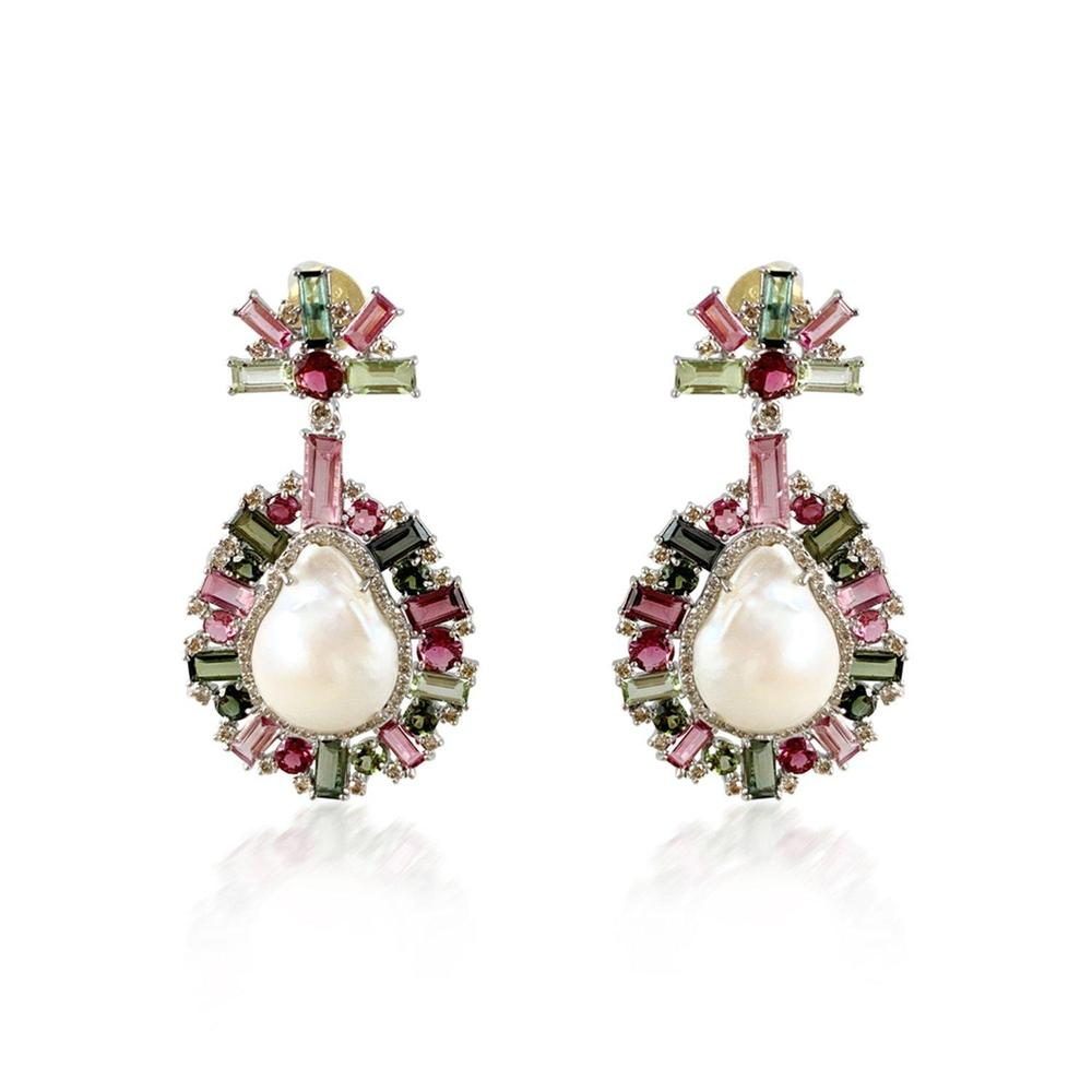Pearls are the gems of queens! Fit for a modern day queen are these Silver (10.75g) earrings that feature 24.49ct Pearls with 26.68 Tourmaline and 2.05ct Diamond that have a 14K Gold (0.18g) post and 18K Gold vermeil butterfly closure. Tourmalines not only show every hue of the rainbow, but also an incredible range of color saturations and tones that give color and uniqueness to each piece. From pink to olive green this exquisite pair is sure to give a note of elegance to that special occasion.