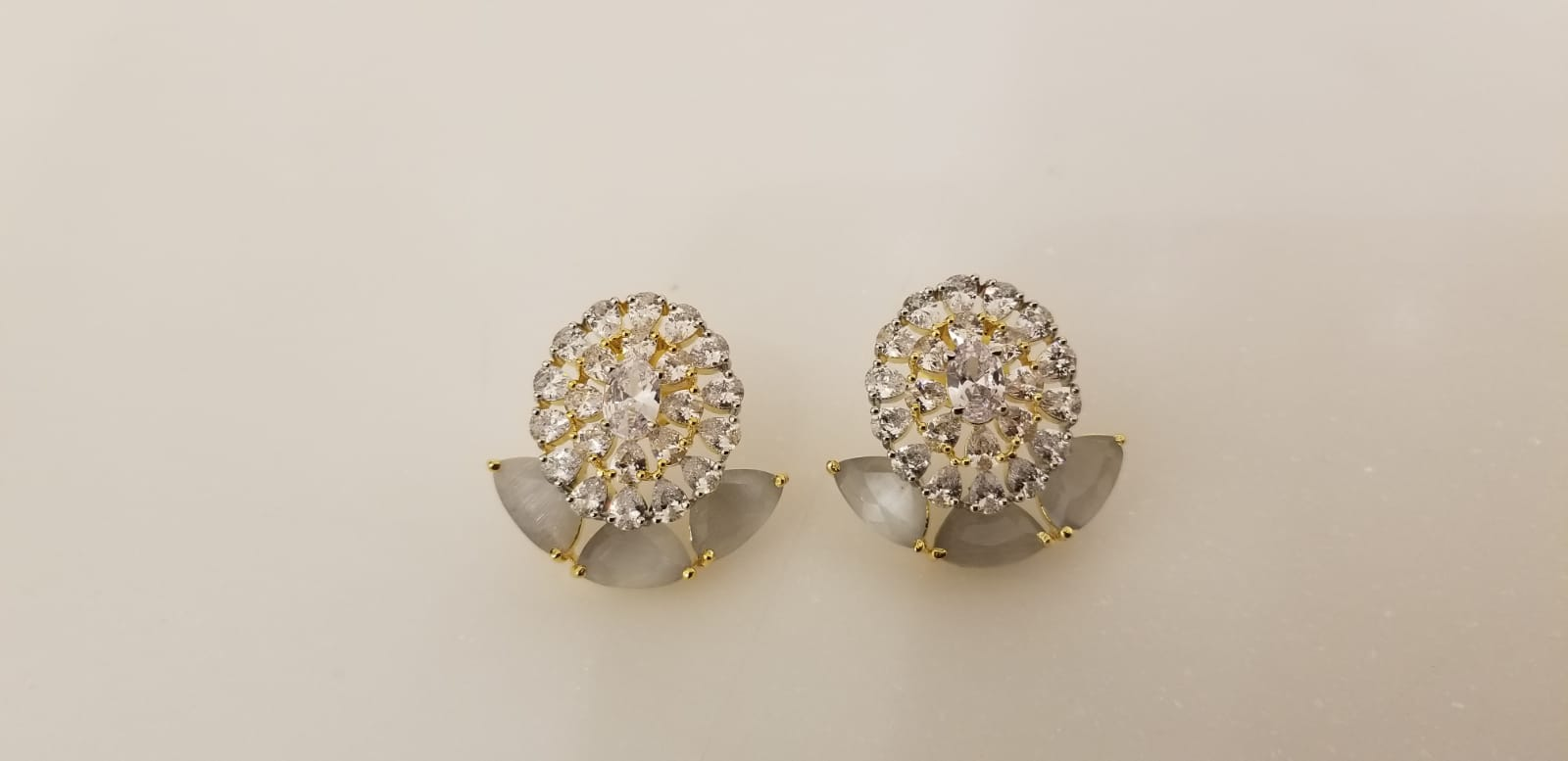 Stud Earrings With Grey Stone and American Diamonds