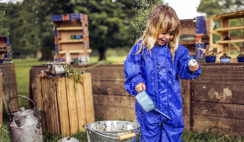 Child Wearing Muddy Puddles Original all-in-one Rainsuit featuring in Little Hot Dog Watsons Blog