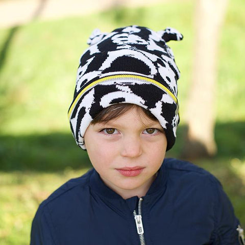Child wearing Little Hotdog Watson Rookie Kids Beanie in monochrome panda pattern as featured on little hotdog watson blog