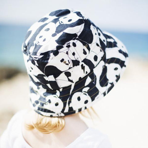 Lifestyle shot of child wearing monochrome panda pattern printed bucket sun hat LHW as featured on little hotdog watson blog