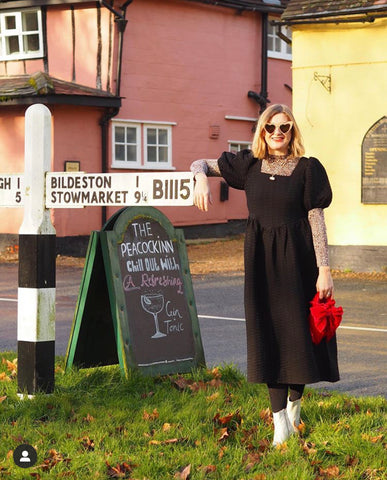 Emma Paton leaning on a sign