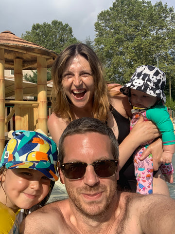 Family of four enjoying time at the pool