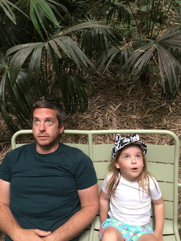 Father and daughter sat on a bench in Anduze