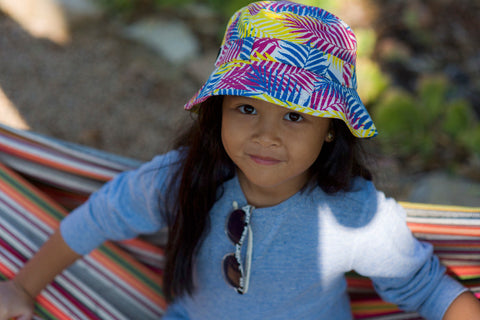 Little Hotdog Watson feature their tropical leaf sunhat in shape adventurer